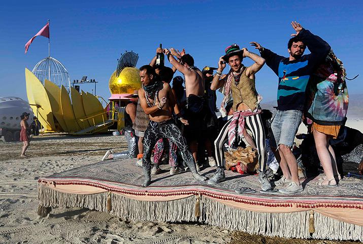 Participants dance on a moving hookah lounge art car